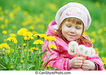 baby with spring dandelion