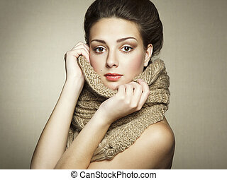 Portrait of a beautiful young woman with scarf. Fashion...