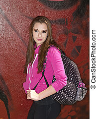 student carrying school bag - Portrait of a student carrying...