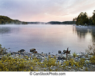 sunset in haliburton - the sun sets spectacularly in...