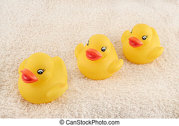 three rubber duckies - three child\\\'s rubber duck on top...