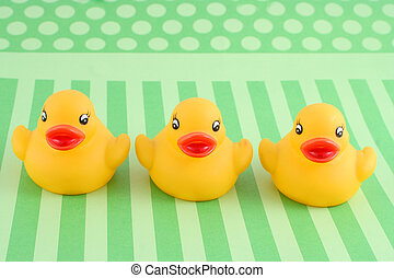 three rubber duckies - three childs rubber duck on top of...