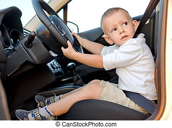 Little boy pretending to drive - Cute little boy pretending...