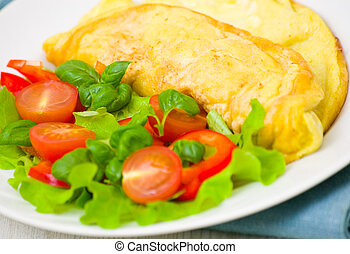Omelet with vegetable salad