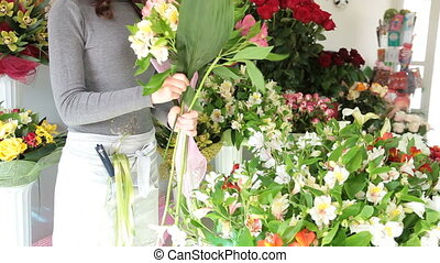 Floristry Shop - Florist Arranging Bunch Of Flowers In...