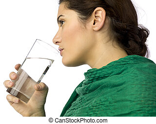 woman drinking water in glass