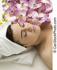 woman on spa with orchids flower