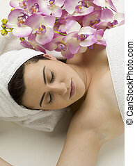 woman sleeping and lying for spa concept