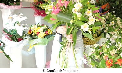 Florist Making Alstroemeria Bouquet - Young Female Florist...
