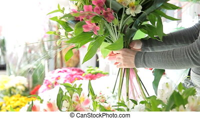 Florist Arranging Bouquet - Young Female Florist Arranging...