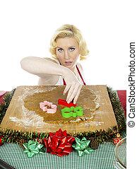 young woman cutting gingerbread dough