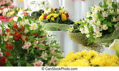 Florist Working In Flower Shop - Young Female Florist...