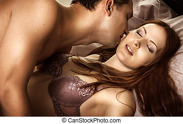 Beautiful sexy couple of lovers. Young man kissing woman in...