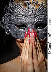 Incognito woman in ancient style mask - Close up shot of...