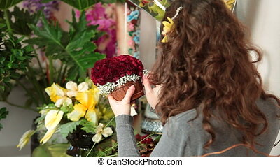 Arranging Rose Heart Bouquet - Florist arranging rose...