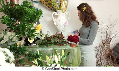 Florist Arranging Rose Heart - Florist arranging rose...