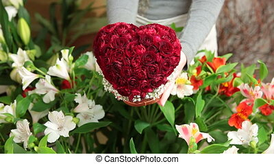 Soulful Floral Gift - A man buying Valentines Day rose heart...