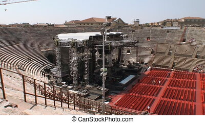 Pan of the Arena op Verona - Worksmen assembling a stage at...