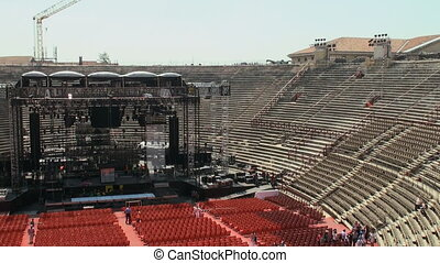Stage at the arena of Verona - Worksmen assembling a stage...