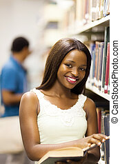 college girl reading in library - cute african american...