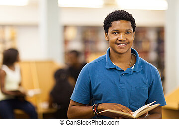 male african college student in library - male african...