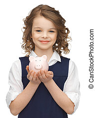 girl with piggy bank - picture of beautiful girl with piggy...