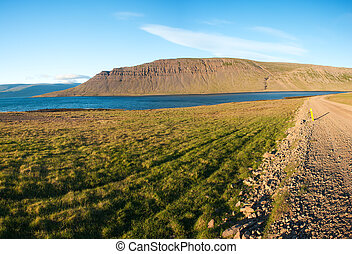 West Fjords - Mighty fjords rise from the sea in the...