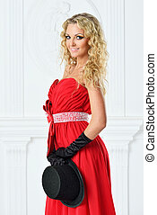 Beautiful woman in a red  dress with  hat.