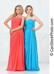 Two beautiful women in evening dresses - Two beautiful women...