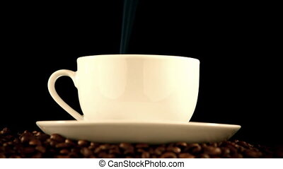 warm cup of coffee on black background