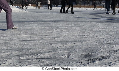 people skate snowy ice