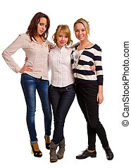 Three beautiful young women friends posing standing together...