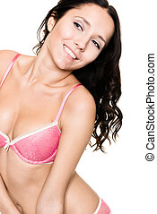 Young woman with lingerie (bikini) in front of white...