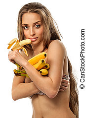 Woman holding bananas - Beautiful young woman holding...