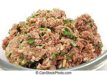 Beefburger pattie mix - A glass bowl full of a mixture of...