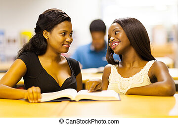 african college girls reading book - two african college...