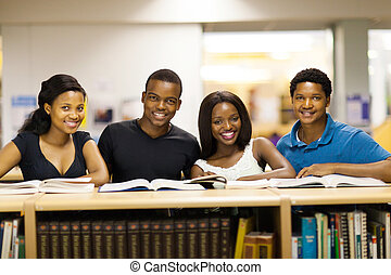 african university students in library - group of african...