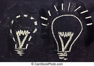 building a concept, funny lightbulb on blackboard - lighbulb...