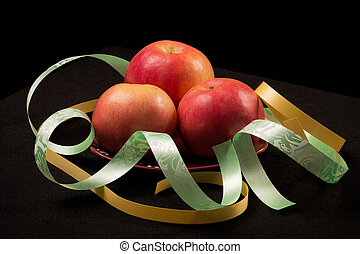 Red apples and color ribbons
