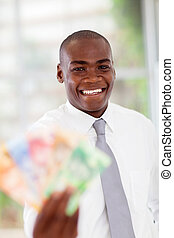 african businessman with cash notes - happy young african...