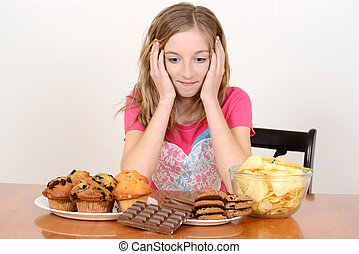 Child with huge pile of junk food - portrait of a Child with...