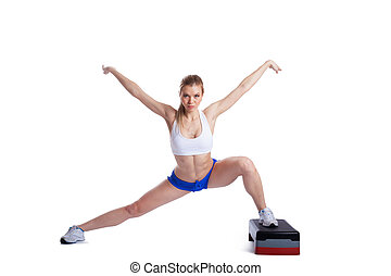 Slim blonde woman with stepper