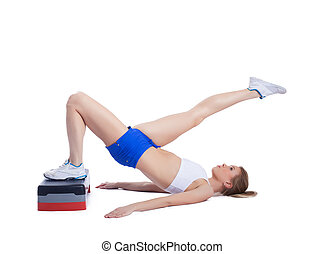 Fitness blonde woman with stepper