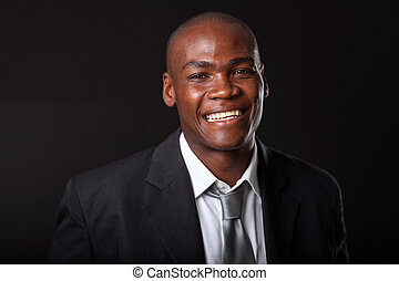 african businessman on black - handsome young african...