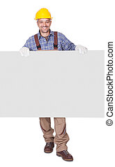 Portrait Of Happy Contractor Holding Placard On White...