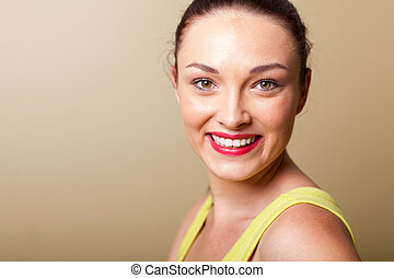 smiling beautiful young woman closeup portrait in studio
