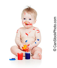 Funny dirty baby boy with paints. Isolated on white background