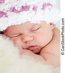 sleeping adorable baby girl weared cap close-up - sleeping...