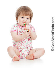 Funny baby  girl with musical toy. Isolated on white background