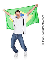 Portrait Of A Happy Man Holding An Brazilian Flag. Isolated...